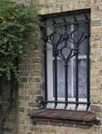 Bortierlaan 39 et Visserslaan 34, La Panne, Villa 'Pan' ou villa personnelle d'Alexis Dumont, petite fenêtre à grille (© T. Verhofstadt, photo 2019)